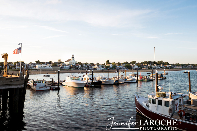 view of provincetown harbor boats at sunset