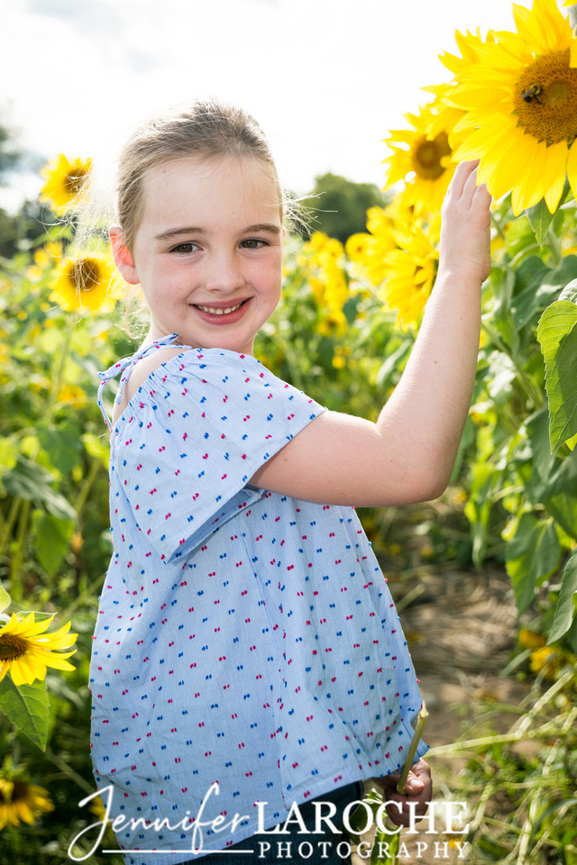 Young-Girl-Portrait-in-Sunflowers