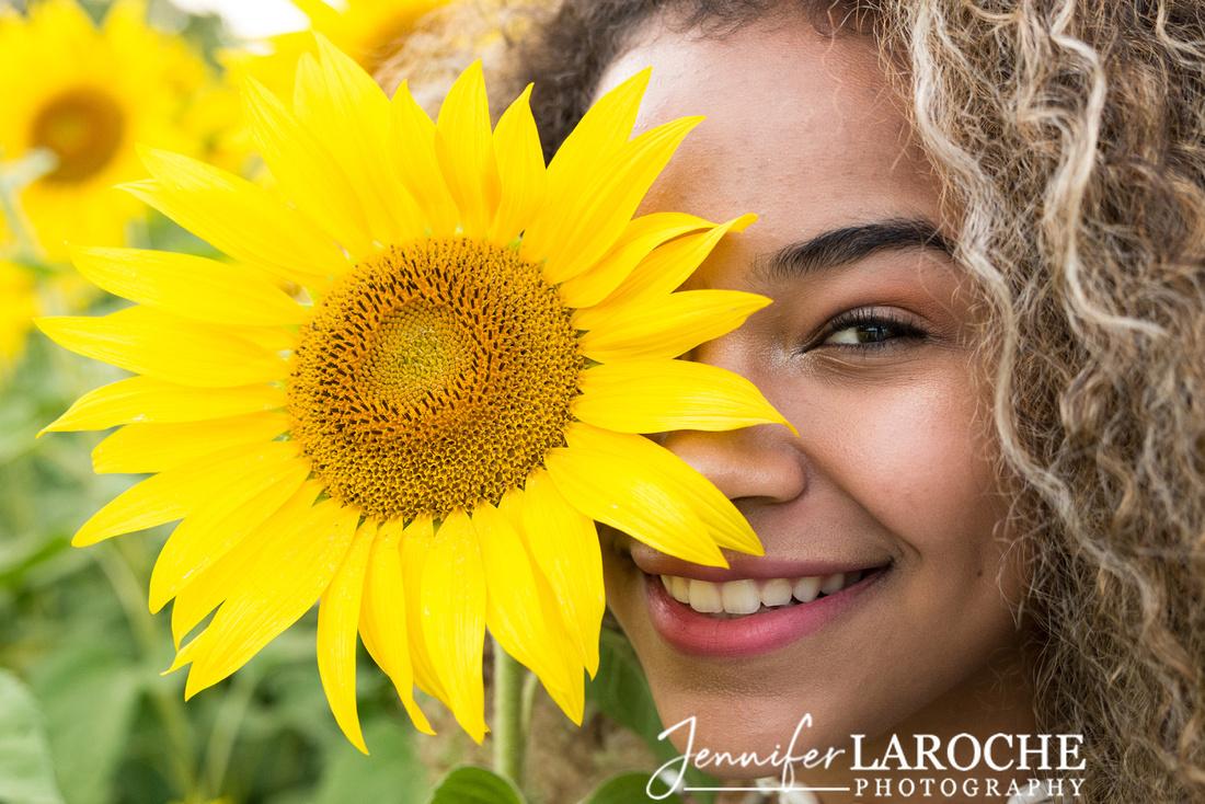 portrait by Jennifer LaRoche teen girl with sunflower over her eye