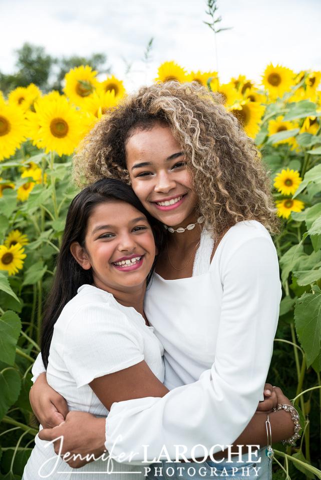 Colby-Farm-Sunflowers-Kids-Sisters-Hugging-Portraits-by-Jennifer-LaRoche