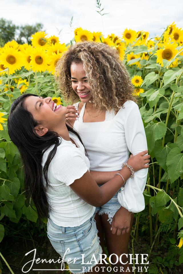 Colby-Farm-Sunflowers-Kids-Sisters-Laughing-Portraits-by-Jennifer-LaRoche