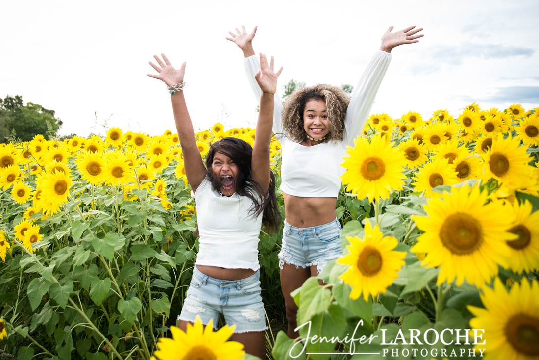 Colby-Farm-Sunflowers-Kids-Sisters-Jumping-Photo--by-Jennifer-LaRoche