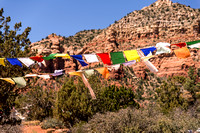 sedona arizona tibetan prayer flags with thunder mountain in the background