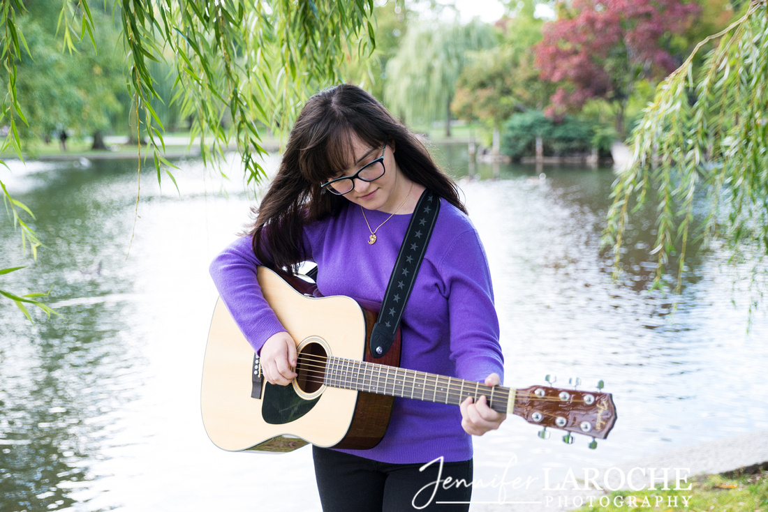 playing guitar at the Boston Public Garden pond
