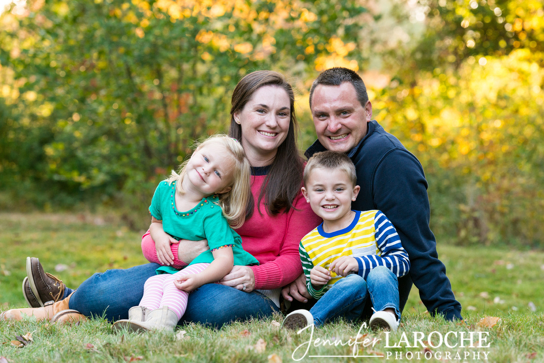 Posed fall family photo of four